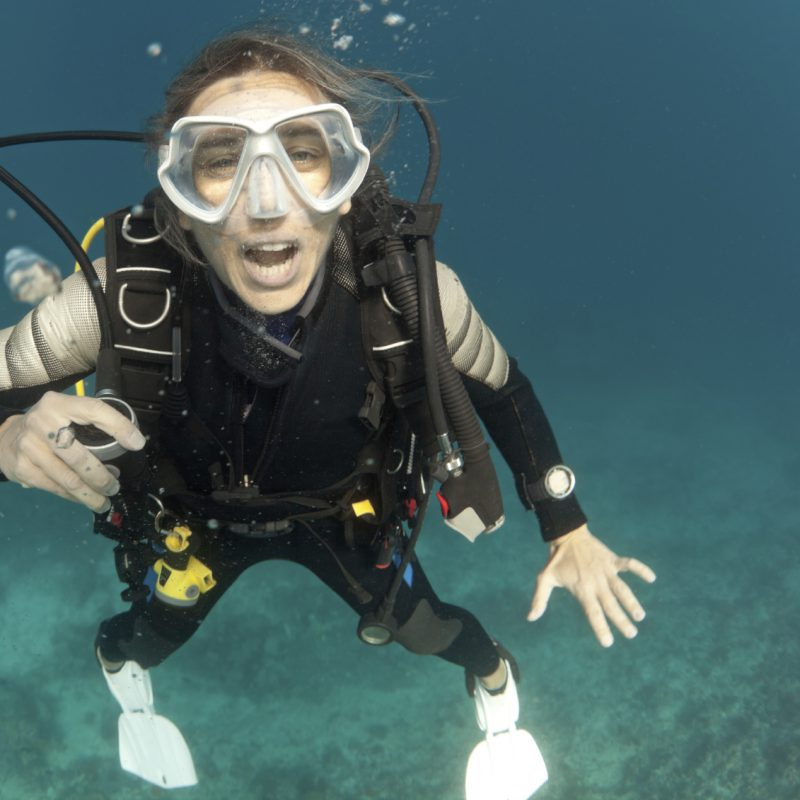 female diver with open mouth underwater